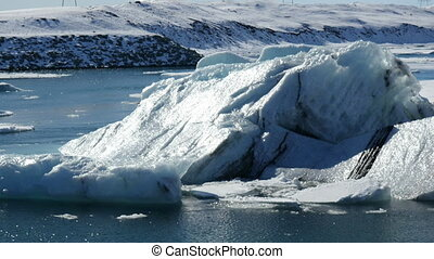Iceberg close up J?kulsarlon - Icebergs moving in the...