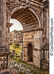 Roman Forum with Arch against sunset in Rome, Italy