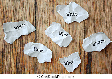 Who, what, when, why, where, how, - Crumpled pieces of paper...