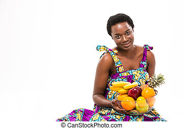 Attractive smiling african woman in colorful sundress...