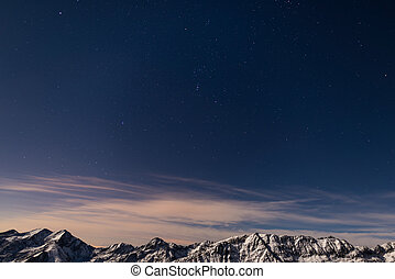 The starry sky above the Alps in winter, Orion Constellation