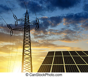 Solar panels with electricity pylon at sunset. Clean energy...