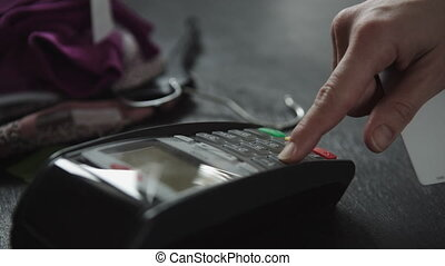 hand swiping credit card in store - hand swiping credit card...