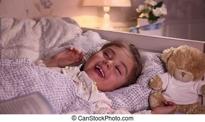 Little girl laughs before sleep - Little girl laughs while...