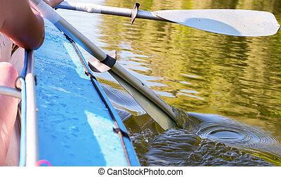 kayak paddle in water
