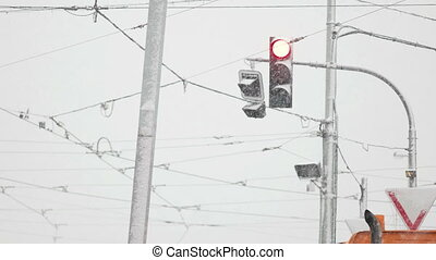 Red Light in Snowstorm - Traffic light stopping cars in the...
