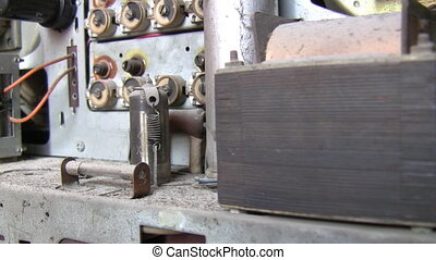 Inside of antique vacuum tube radio - Dolly shot of opened...
