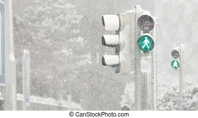 Heavy Snowfall on the Crossway - Green light shining at the...