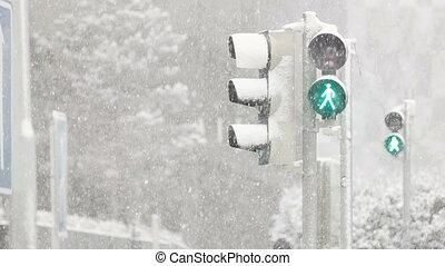 Heavy Snowfall on the Crossway - Green light shining at the...