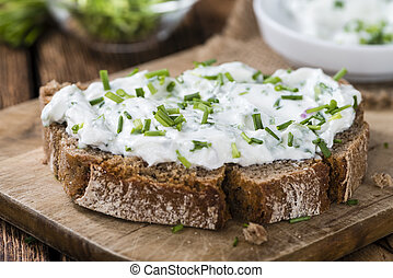 Slice of Bread with Herb Curd (detailed close-up shot)