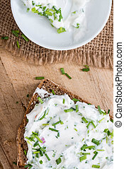 Slice of Bread with fresh made Herb Curd detailed close-up...