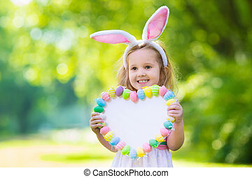 Little girl with white board for Easter greetings - Little...