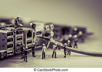 Team of techs connecting network cable.