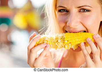 Woman in bikini eating corn Summer and heat - Close up of...