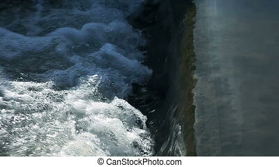 water flows - water changes from a smooth flow to a churning...