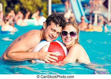 Couple with sunglasses in swimming pool. Summer and water. -...