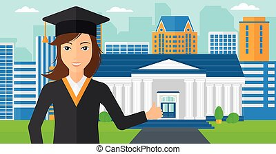 Graduate showing thumb up sign - A woman in cloak and hat...