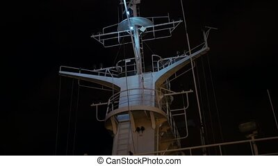 Ships antenna and navigation system on ferry at night