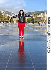 Woman standing in the middle of the Fontaine du Soleil on...