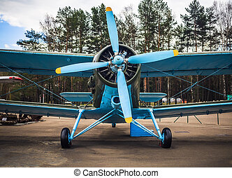 Blue retro airplane - Blue airplane with propeller Vintage...
