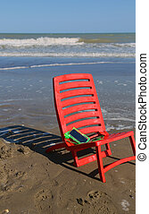 chair on the beach by the ocean wave