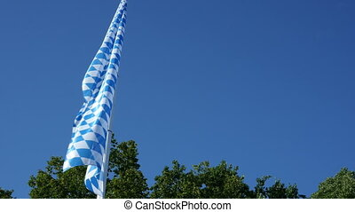 Bavarian Flag - Bavarian flag moving in the wind with a blue...