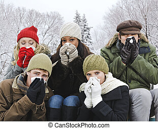 Group of friends with colds outside in winter - Group of...