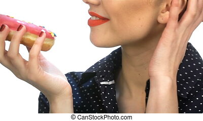 Close up pin up girl with donut. Beautiful young woman with...