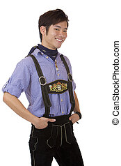 Closeup of young man dressed in Bavarian Oktoberfest leather trousers, which smiles happy into camera. Isolated on white.