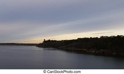 Panorama of bridge from Island to Stockholm filmed during sunrise from a cruise ferry approaching to Sweden