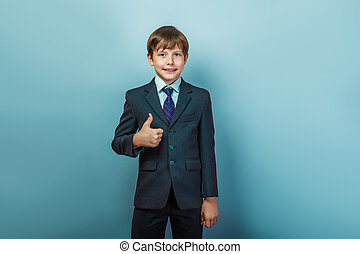 Boy  in a business  suit with thumbs up