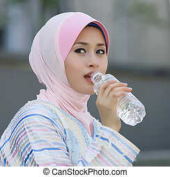 beautiful muslim women are drinking water