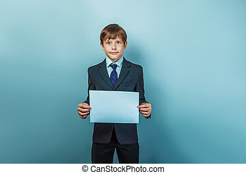 Boy in a business suit holding a blank sign