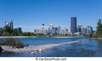 4K Time lapse of Calgary Skyline at daytime with Bow river...