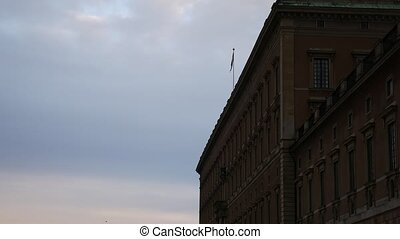 Riksdag Parliament Building and the swedish flag in...