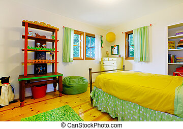 Colorful interior of kidsbedroom with yellow bedding. -...