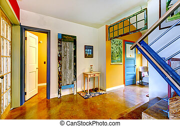 Unique entryway to home with very colorful interior. -...