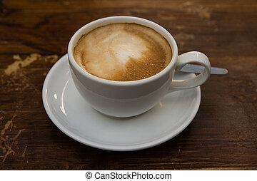 Cafe Latte - Close up of a cup of caffe latte coffee on a...