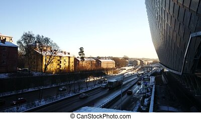 Establishing shot of Stockholm, car traffic and global arena
