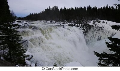Sweden Tännforsen waterfall, winter, wide shot