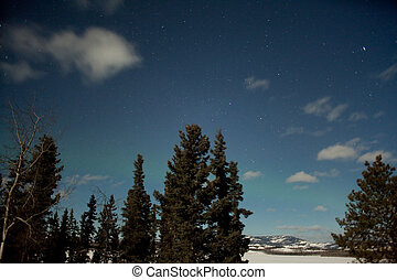Moon light and faint aurora borealis (northern lights) -...
