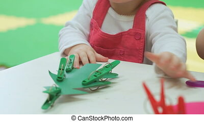 Two-year old baby girl plays with toys - Two-year old baby...