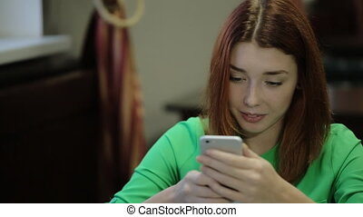 Women takes in hands the smartphone and texting on mobile...