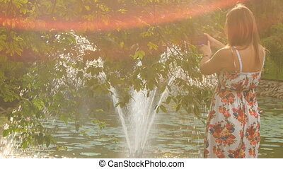 Backlight Backside Blond Girl Photos Fountain in Pond