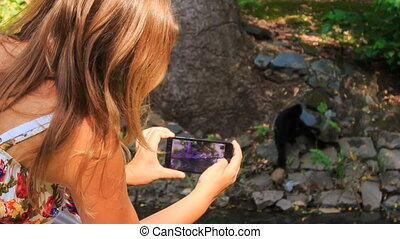 Closeup Backside Blond Girl Takes Photo of Monkey in Park -...