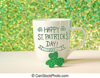 Green clover with white mug