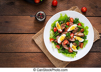 Warm salad with chicken liver, green beans, eggs, tomatoes...