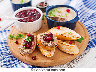 Chicken liver pate with cranberry sauce, served with...