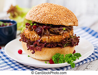 Hamburger with juicy turkey burger with cheese, caramelized...