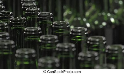 Bordeaux Saint Emilion bottling - conveying empty bottles to...